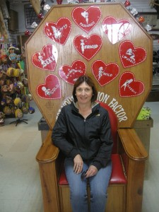 """Kathy in a tacky tourist trap - for 25 cents, a vibrating chair tells you what sort of lover you are - her light came up flashing """"sexy"""" - I can't deny this...."""