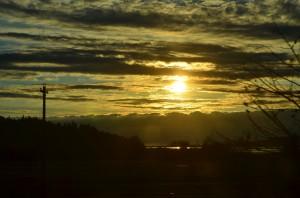 Sun setting over Oregon Dunes