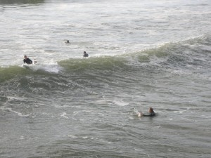 """""""Cali boys"""" surfing beside the Pismo Pier"""