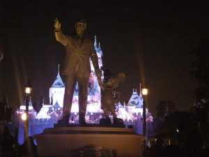 Walt and Mickey in front of the beautifully lit Castle