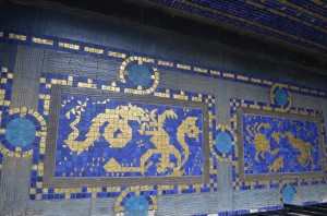 Gold inlays in the floor tiles along the pool