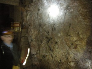 Mine wall wired with explosives - ignited at end of shifts