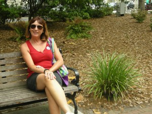 """Kathy sitting at a bench in the one Square where Forrest Gump was filmed when he said """"Life is like a box of chocolates....."""""""