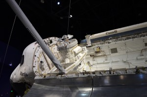 The large round connection behind the capsule used for docking to the ISS