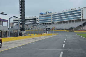 Pit row looking down at Turn 1 - 24 deg banking